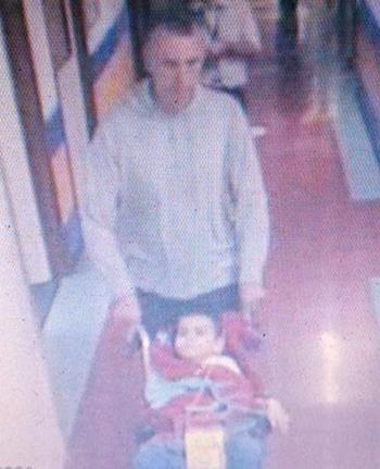 CCTV image of Brett King and Ashya King leaving Southampton General Hospital