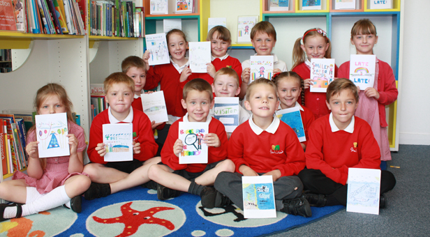 Pupils from Sylvan Infant School with their published books at Poole Central Library