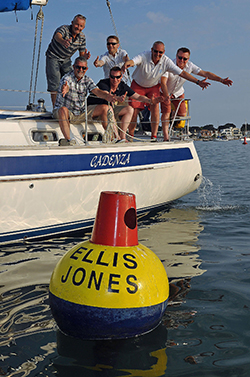 Mad about the buoy: Ellis Jones partners, including Nigel Smith, Managing Partner (second right), inspect the Ellis Jones' buoy in Poole Harbour