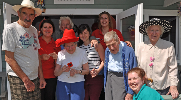 Tribute: Staff and residents at Colten Care's The Aldbury who held a poppy picnic to mark the 100th anniversary of Britain joining World War One