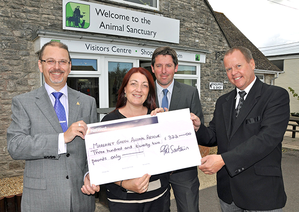 Malcolm Green of James Smith Funeral Directors in Swanage, Caron Lane from the charity, and Mark Alder and Jonathan Stretch from Albert Marsh Funeral Directors