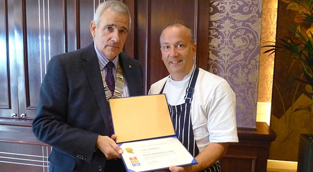 Luke Matthews receives award from Wimborne Rotary President Derek Radley