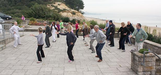Free mass tai chi session at Branksome beach
