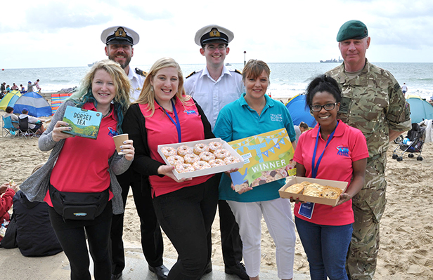 CSgt Pete Wooldridge, Lt Phillip Morgan, Lt Paul Fegan. Front (l-r) Jennifer Steel, the winner Rosie Ryves-Webb, Fiona Harwood-Smith from Yellow Buses, and Akeshia Clarke