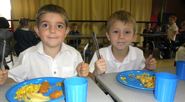 ENJOYING HOT SCHOOL DINNERS