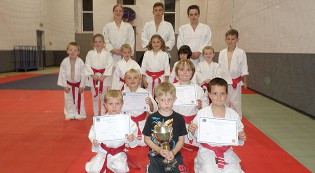 Mini Jitsu group members Alfie, Ben, James and Riley with certificates with Hatamoto Sensei John Hanrahan, Sensei Oliver  Preston and Instructor Katie Dudley