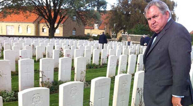 Bob Walter visiting memorial graves at Ypres