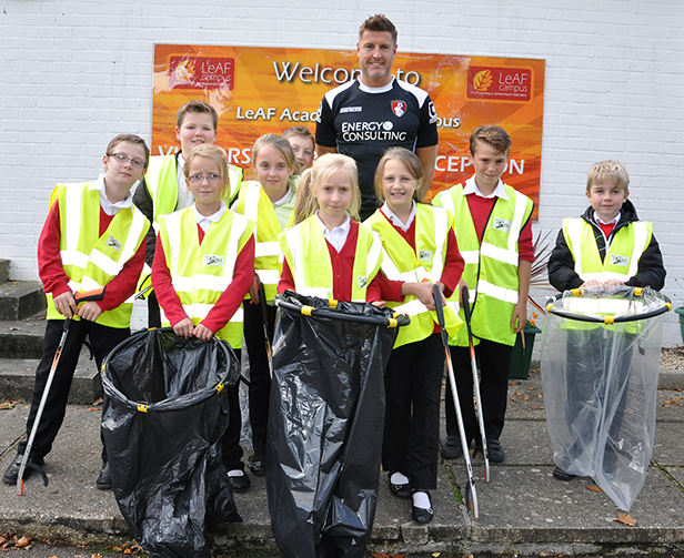 AFC Bournemouth's Steve Fletcher joins year 5 students from the Elm Academy for a litter pick around the West Howe area of the town
