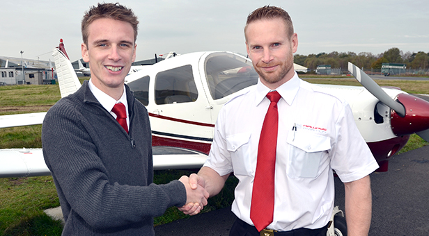 (from left) Airways Aviation's Ollie Pennington Congratulates Mike Allinson