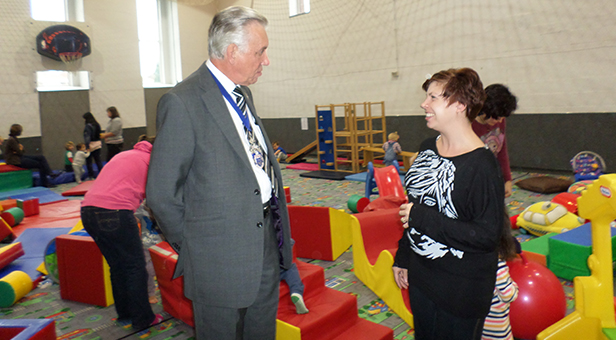 Chairman of East Dorset District Council, Cllr Robin Cook with Lisa Guy at the Soft Play Group