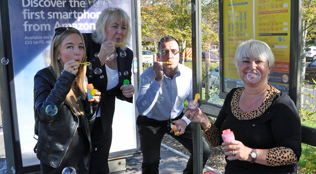 Jenni Wilkinson, right, and other Yellow Buses staff, blow bubbles for IPF.