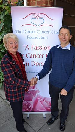 GENEROUS HANDSHAKE: DCCF Chairman Pam Jeffries thanks Steve Blonstein for his six-figure donation.