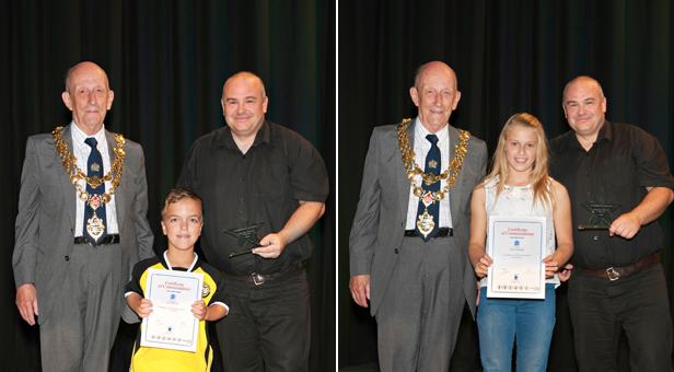 Macie Schmidt and Leo McCrea with their awards