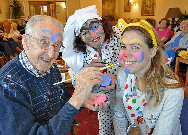 Carlie Nicholas has her face painted by Kingfishers resident Jack Tolson