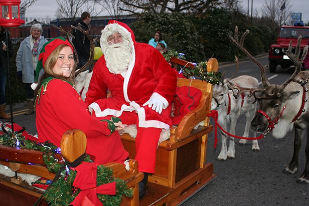 Santa elf with reindeer