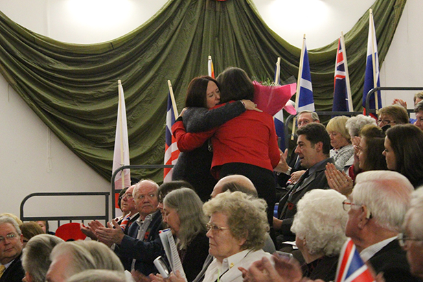 Karen receives a bouquet from Cllr Toni Coombs