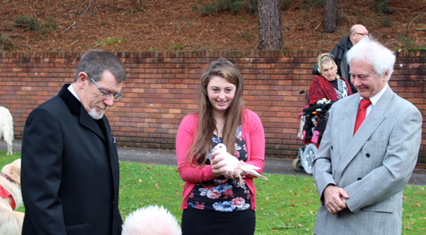 Sarah with a dove just before she and her father Andy released one each as a final farewell