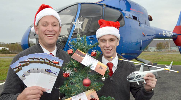 (from left) Operations Manager Nick Bird and Ollie Pennington promote festive gift flights for budding pilots