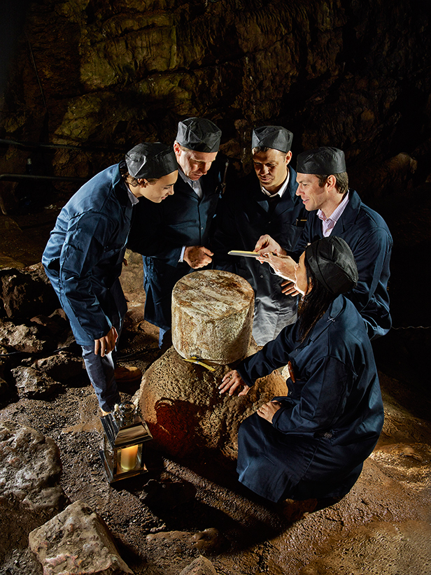 Wookey Hole provides an atmospheric back drop for the grading of Wookey Hole Cave Aged Cheddars for Christmas. The Cheddars, which are stored in 27kg wheels take around nine months to mature and assume the full, earthy, nutty flavour of the Caves.