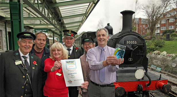 Richard Jones with the award and Swanage Railway volunteers at Swanage station © Andrew PM Wright.