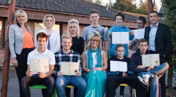 Young volunteers from Muscliffe Youth Centre proudly display their certificates alongside Bournemouth 2026 Trust trustee Caron Khan (left), Helen Hender, BCVS (centre) and Geraint Griffiths, Head of Bournemouth Integrated Youth Service (right)