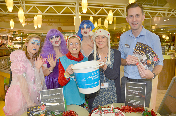 Haskins Staff as Ugly Sisters join Alzheimer's Society volunteer Mary Rackham and Service Manager Jo Malyon with Matt Hill