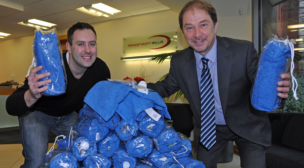 Nick Love, Princecroft Willis' Charity Director and Neil Robertson, Projects Coordinator, Routes To Roots, with the 100 wash kits