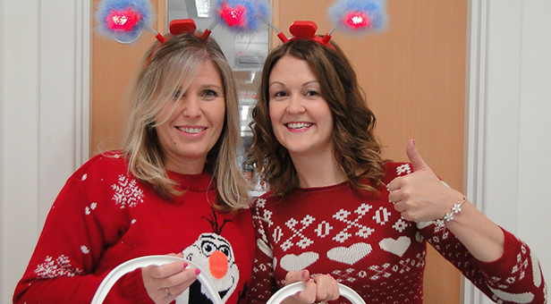 Sally Goodenough and Louise Jones from Lewis-Manning's Fundraining Team in their Christmas Jumpers