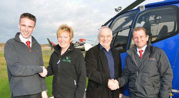 Ollie Pennington welcomes Linda Thornton with Peter Thornton and ground school instructor Ian Brookes.