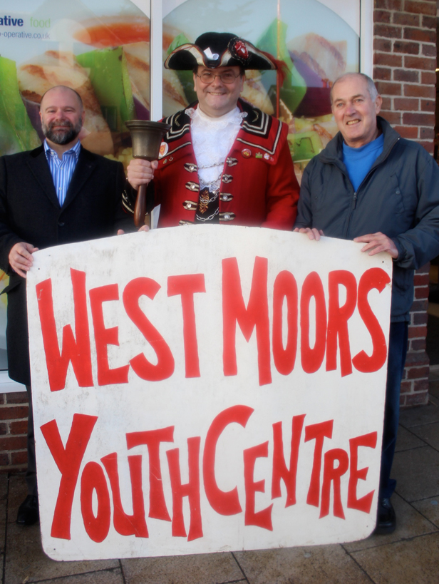 Oyez! Oyez! L-R Chair of West Moors Youth Club Kurt Hallam with the village crier and youth club supporter Iain Mitchell, and Godwin Micallef, secretary of West Moors Youth Club
