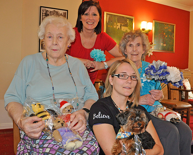 With their handmade teddy bears and paper flowers are resident Irene Brown (left), Activity Organiser Sandra Boulton and resident Betty Elvy at Colten Care's Avon Reach care home in Mudeford, pictured with stroke campaigner Claire Whitehouse