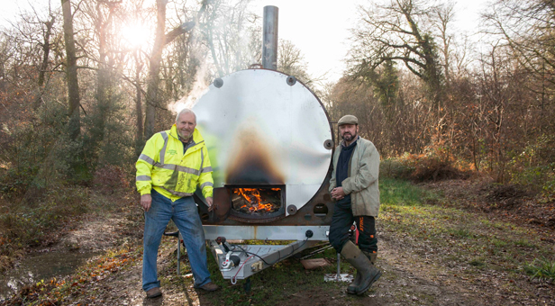 Pondhead Conservation Trust volunteers Derek Tippetts and Dave Dibden stand by the group's charcoal burner.
