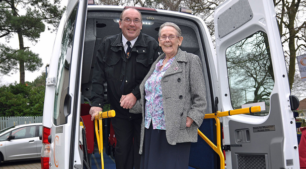 Pam boards the bus with driver Kevin Surgeon