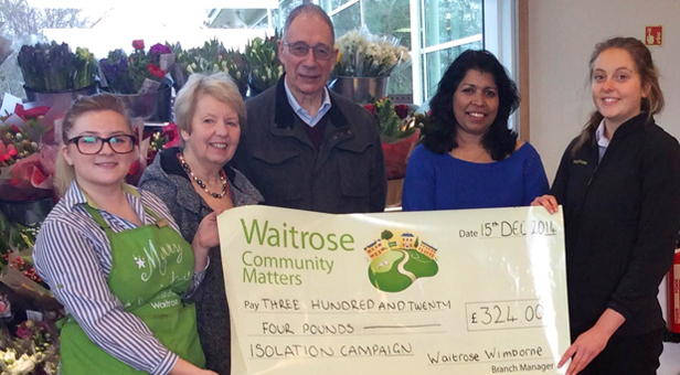 Lynne and John Ewins receive a share of community sponsorship funds from Alison Good, Local Co-Ordination Manager at Waitrose
