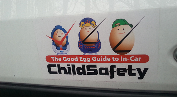 A photo of the egg cartoon sticker on the back of Alexander's van