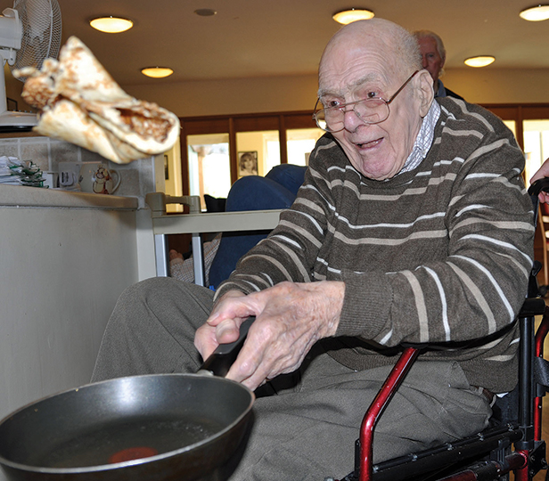 George Collins, 91, a resident at Colten Care's The Aldbury, takes part in the home's pancake time trial