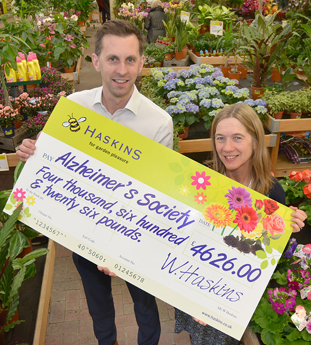 Matt Hill (left) presents the £4626 cheque to Jo Malyon on behalf of customers and staff