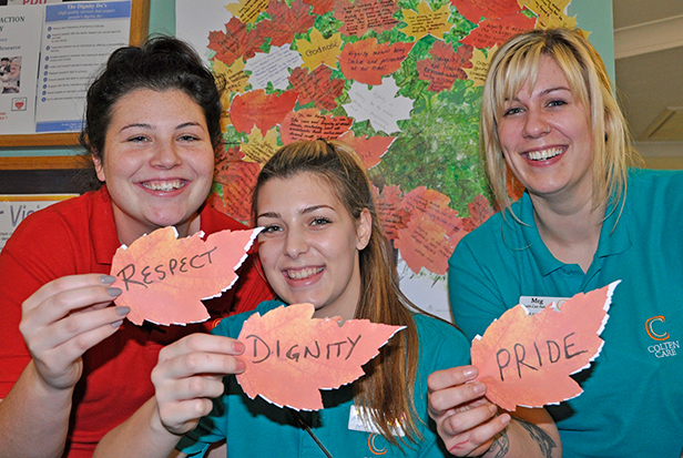 Team members at The Aldbury dementia care home in Poole prepare to post thoughts on their'Digni-tree'. L-r: Bianca Turner, Activities Organiser, and Healthcare Assistants Jodie Sherwood and Megan Austin