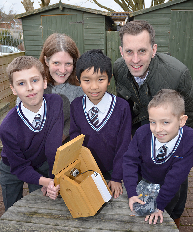 Alex Bushnell, Christopher Yong and Luke Kelly examine their new nest box with Emma Haworth and Matt Hill