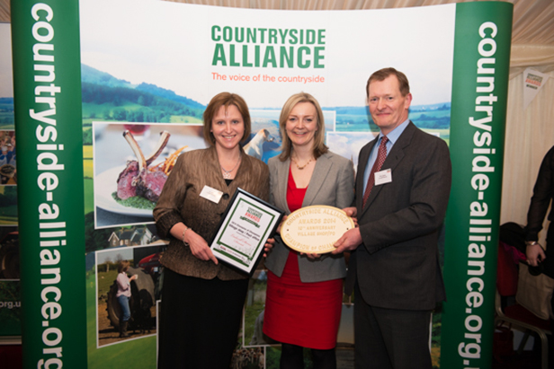 Jo and Phil James with Liz Truss (centre)