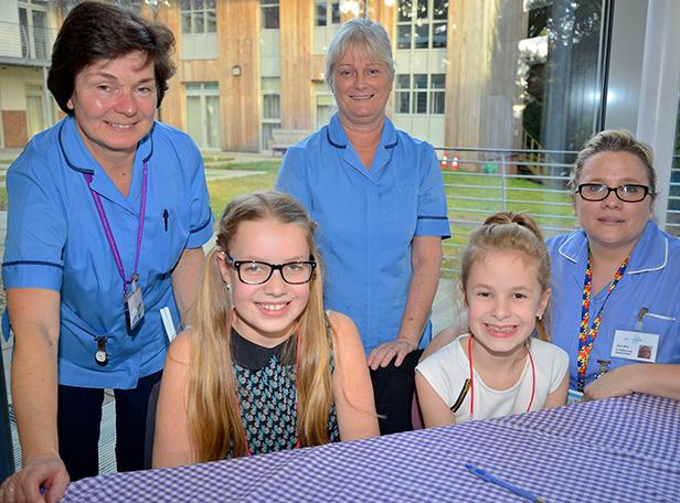 Nikki's daughters Leah & Megan with Lewis-Manning nurses at book launch