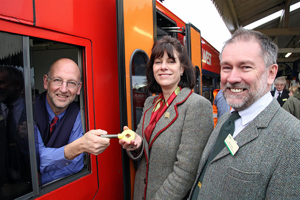 Driver Pete Burton & Claire Perry with key token & Gavin Johns