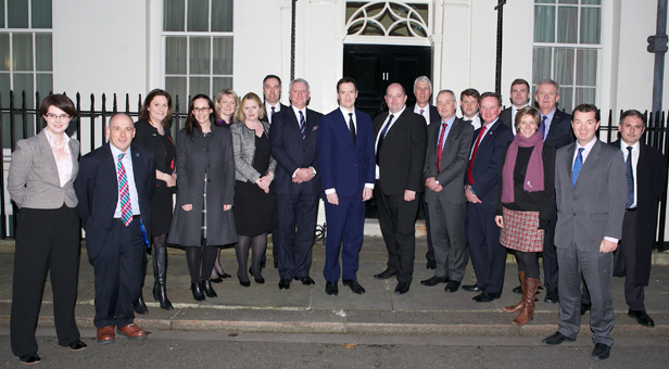 Representatives from air ambulance charities, the AAA and MPs gather outside No 11 Downing Street