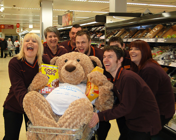 Lewis Bear with staff at Sainsbury's Poole