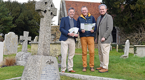 Frank Green, National Park archaeologist; Canon Stuart Holt, Fawley Church, and Julian Lewis MP stand by the grave of Samuel Kinkead