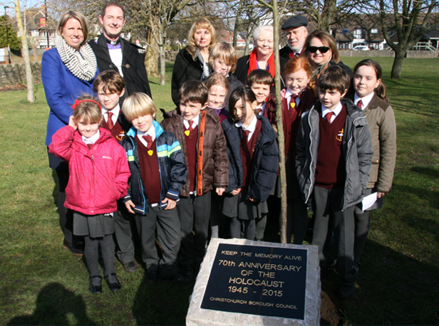 Holocaust memorial unveiled: (back row from left) Head of The Priory School Claire King, Revd Richard Partridge, Dr Josie Lipsith, The Mayor Cllr Denise Jones, Rabbi Adrian Jesner and Bilha Weider with (in front) children from The Priory School