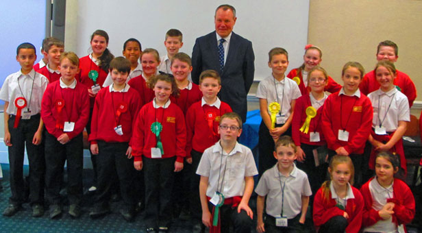 Children from the Elm Academy with Bournemouth West MP Conor Burns, during their visit to the Houses of Parliament.