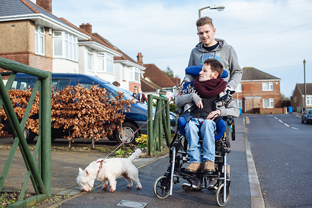 Graeme and his support worker taking Amber the dog for a walk