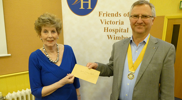 President Elect Alan Griffiths presenting cheque to Rae Cotton