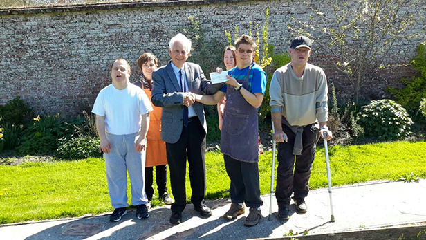 Cheque presentation to Stable Family Home Trust